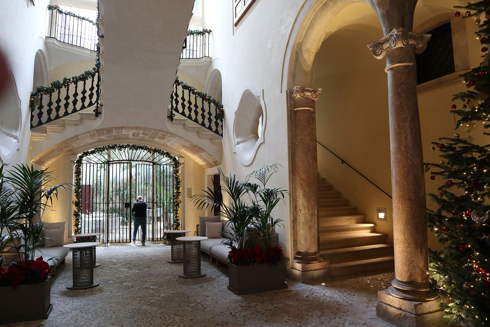 Majestic soaring ceilings and elegant staircases in the lobby
